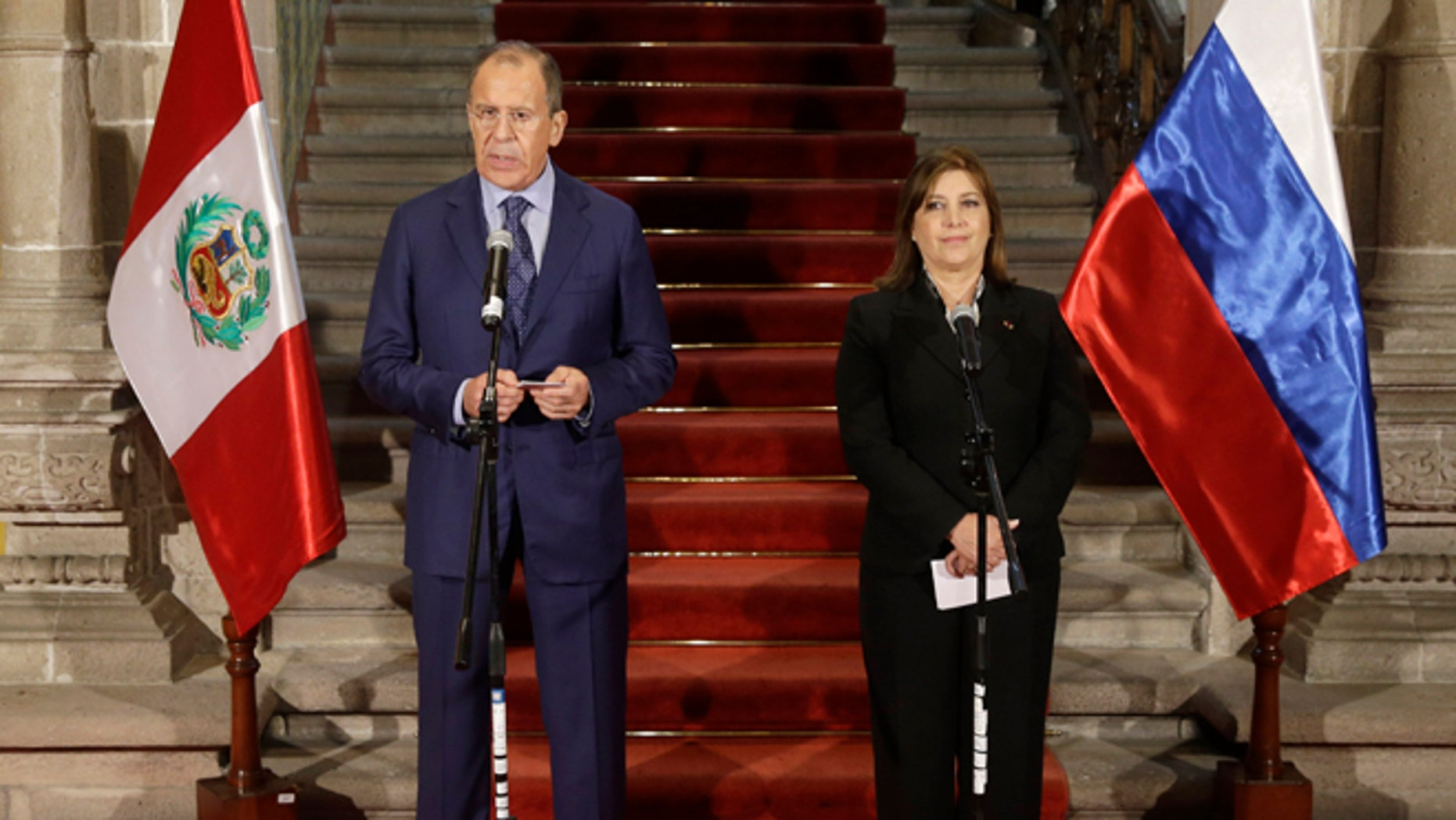 Russian's Foreign Minister Sergey Lavrov, talks during a joint press conference, next to Peru's Foreign Minister Eda Rivas at the Foreign Ministry building in Lima, Peru, Wednesday, April 30, 2014. Lavrov is Lima, for a visit of one day in his tour of Latin America. (AP Photo/Martin Mejia)