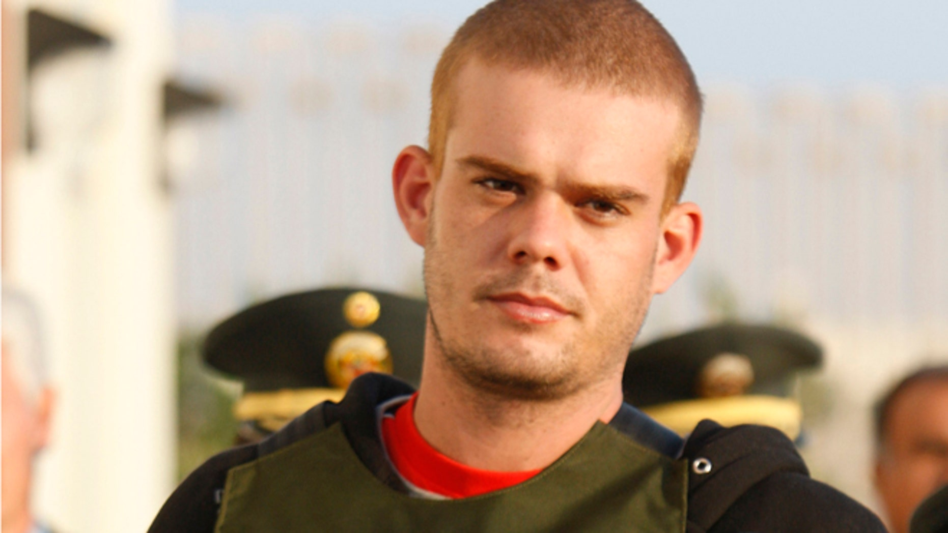 June 4, 2010: In this file photo, Joran Van der Sloot, top, is escorted by police officers outside a Peruvian police station, near the border with Chile in Tacna, Peru.