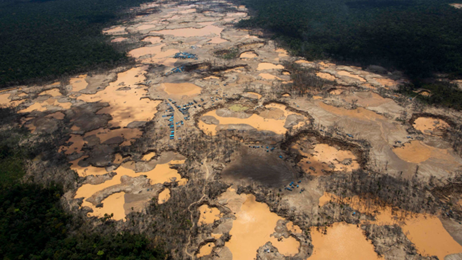 Craters filled with water, caused by illegal gold mining activities, in La Pampa, in Peru's Madre de Dios region.
