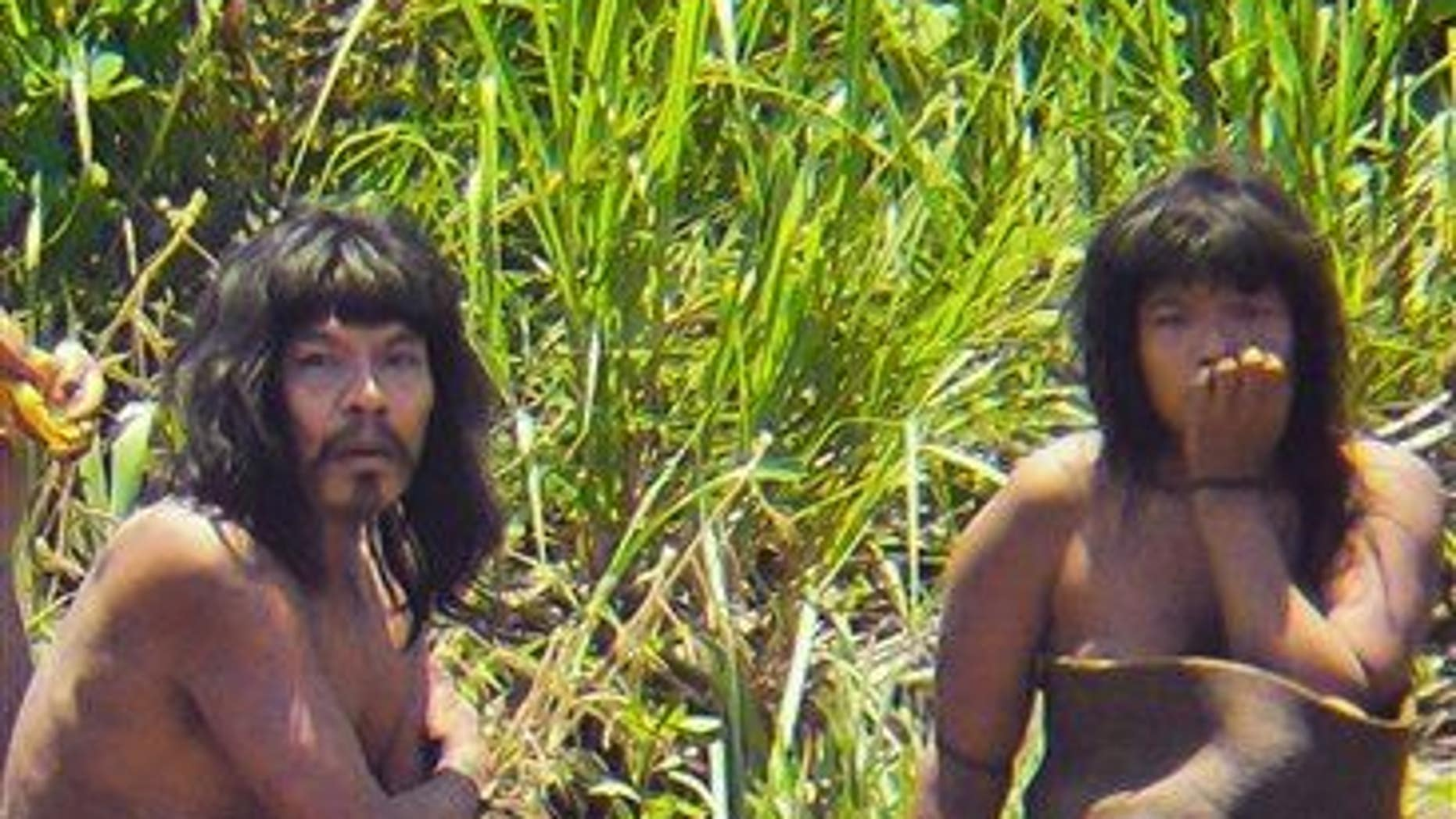 This 2011 photo shows members of the Mashco Piro tribe, photographed at an undisclosed location near the Manu National Park in southeastern Peru.
