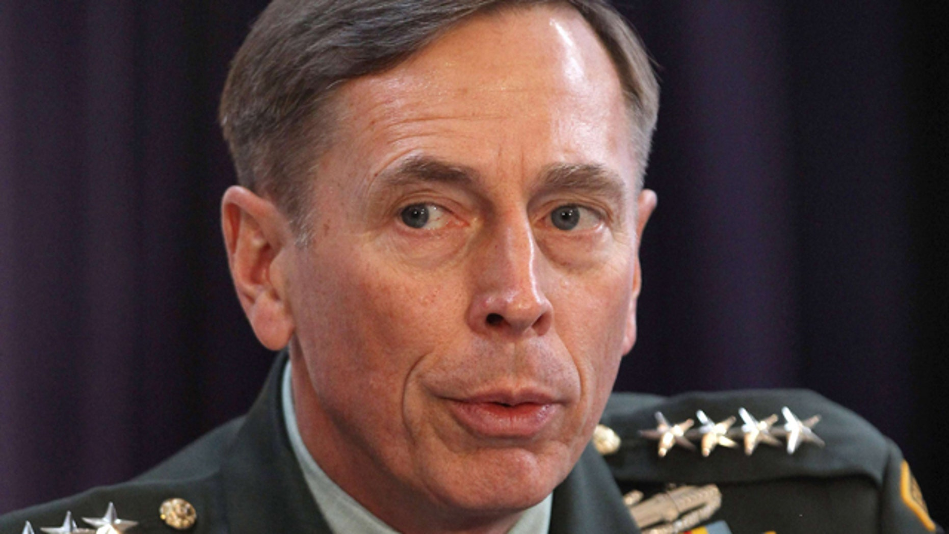 FILE - In this Friday Oct. 15, 2010 file photo, Gen. David Petraeus, the top U.S and NATO commander addresses RUSI members on 'The International Mission in Afghanistan' at the United Services Institute in central London. (AP Photo/Dan Kitwood, Pool, File)