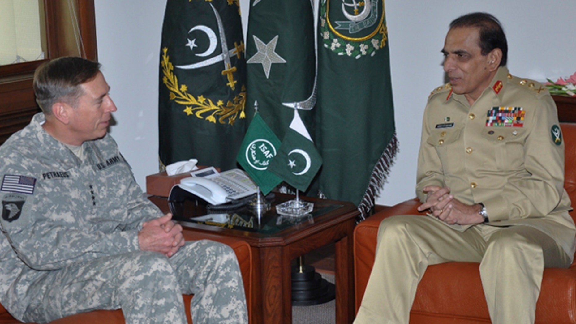 July 12: This photo made available by the Inter Services Public Relations department, shows U.S. Gen. David Petraeus, meeting Pakistan's army chief Gen. Ashfaq Parvez Kayani in Rawalpindi, Pakistan. (AP Photo/Inter Services Public Relations Department)