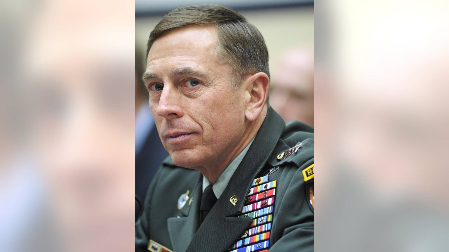 Army Gen. David Petraeus delivers testimony to the House Armed Services Committee Wednesday. (AP Photo)