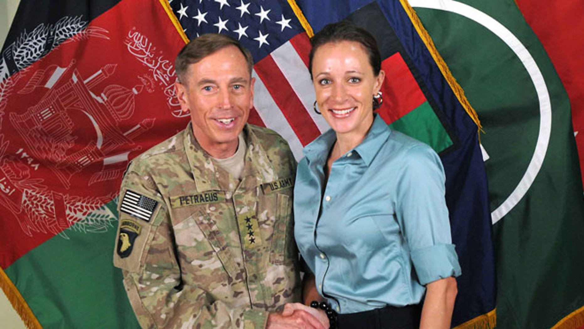 FILE: July 13, 2011: Retired Army Gen. and ex-CIA Director David Petraeus with biographer Paula Broadwell.