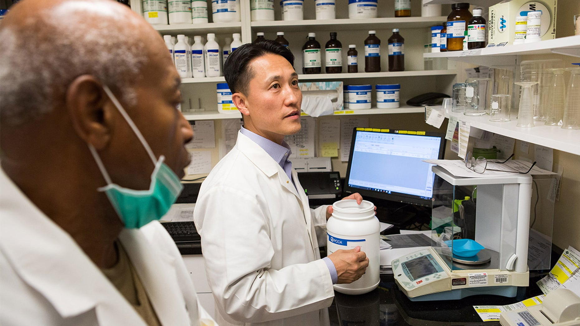 On October 6, 2017, Dr. Michael Kim (center), a pharmacist and owner of Grubb's Pharmacy, prepares medication in the compound of his Northeast, Washington D.C. store with Ron Thompson(left, Compound Technician). Grubb's Pharmacy, established in 1867, is the oldest pharmacy in D.C., and with its convenient location to the U.S. Capitol, services many Members of Congress.