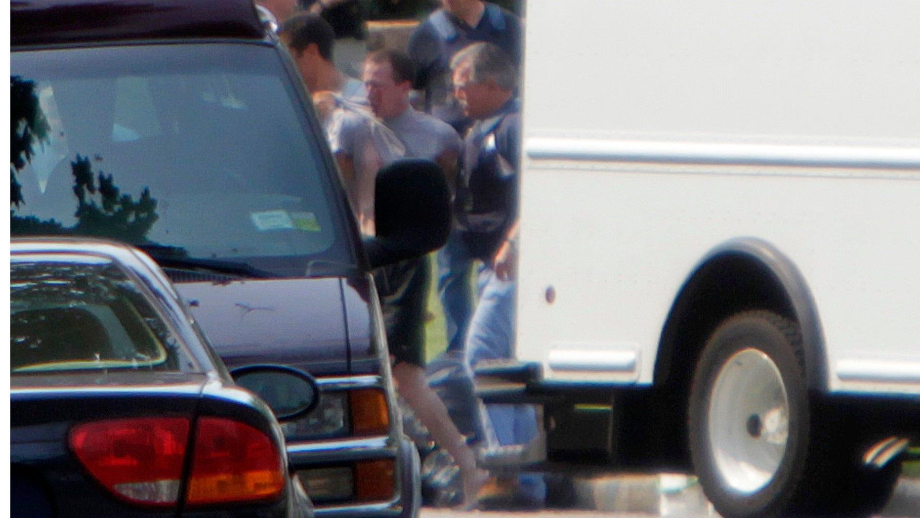Suffolk County police  in Medford, N.Y., Wednesday, June 22, 2011.