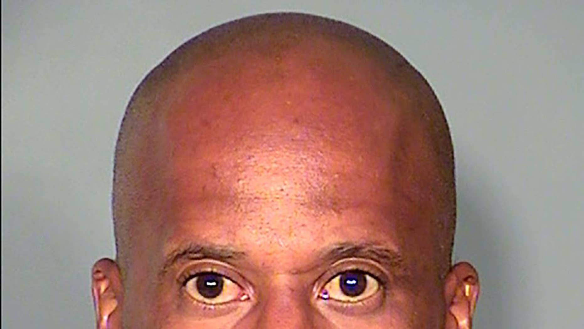 This Thursday, Aug. 6, 2015 booking photo released by the Las Vegas Metropolitan Police Department, shows suspect Leonard Ray Woods, 46 at the Clark County Detention Center North in Las Vegas.  Police say security video shows Woods stalking and fatally stabbing his estranged girlfriend outside a Las Vegas pharmacy hours before he turned himself in. (Las Vegas Metropolitan Police Department  via AP)