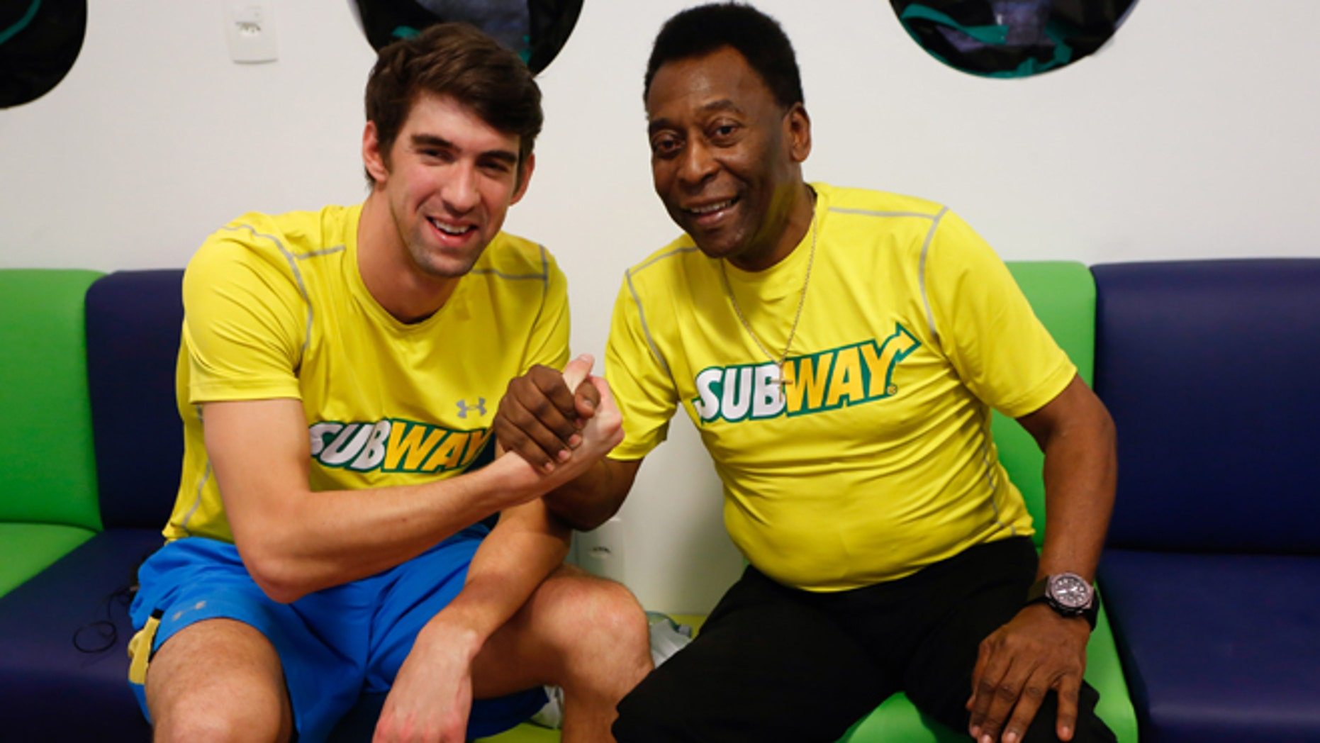 Michael Phelps and Pele at a press conference to promote healthy lifestyle among children on December 04, 2013 in Sao Paulo, Brazil.