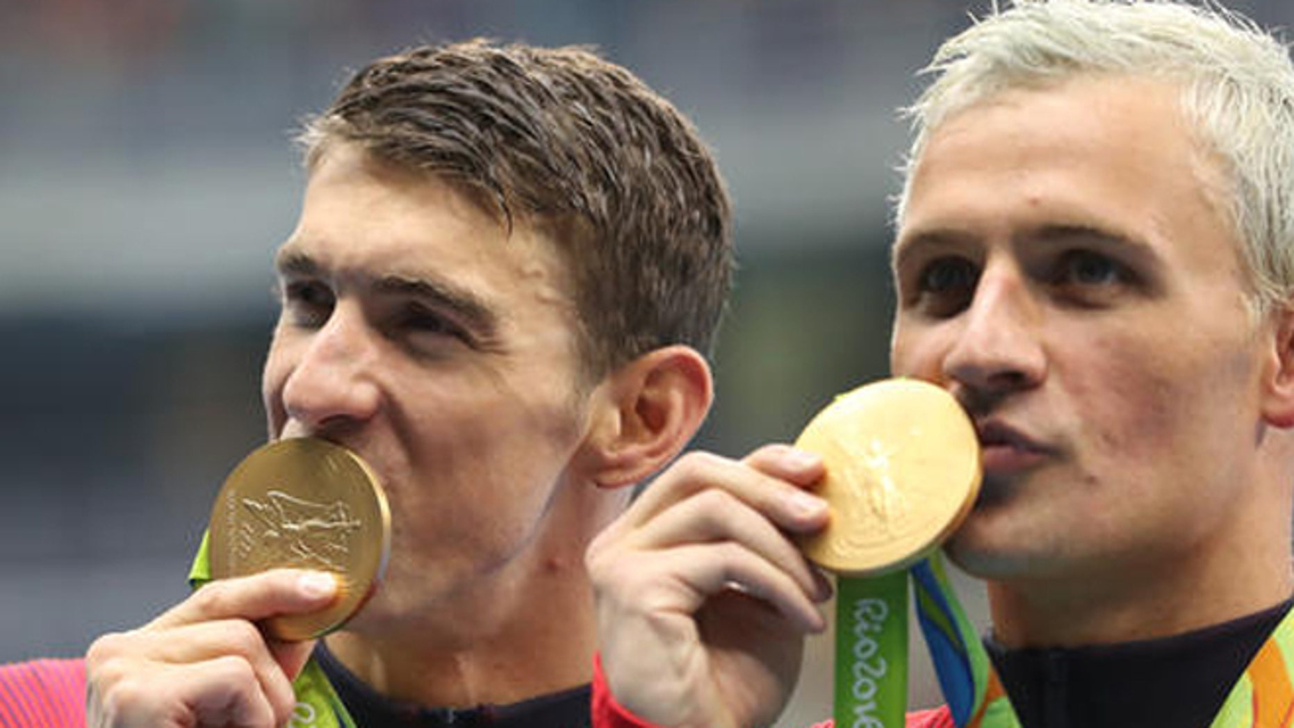 """FILE - In this Wednesday, Aug. 10, 2016, file photo, United States' Michael Phelps, left, and Ryan Lochte celebrate winning the gold medal in the men's 4x200-meter freestyle relay during the swimming competitions at the 2016 Summer Olympics in Rio de Janeiro, Brazil. Phelps isn't sure what kind of moves Lochte has planned for """"Dancing with the Stars."""" """"I've never seen him dance,"""" the 23-time Olympic gold medalist said Friday, Sept. 2, at the """"Call of Duty"""" fan convention in Inglewood, Calif. (AP Photo/Lee Jin-man, File)"""