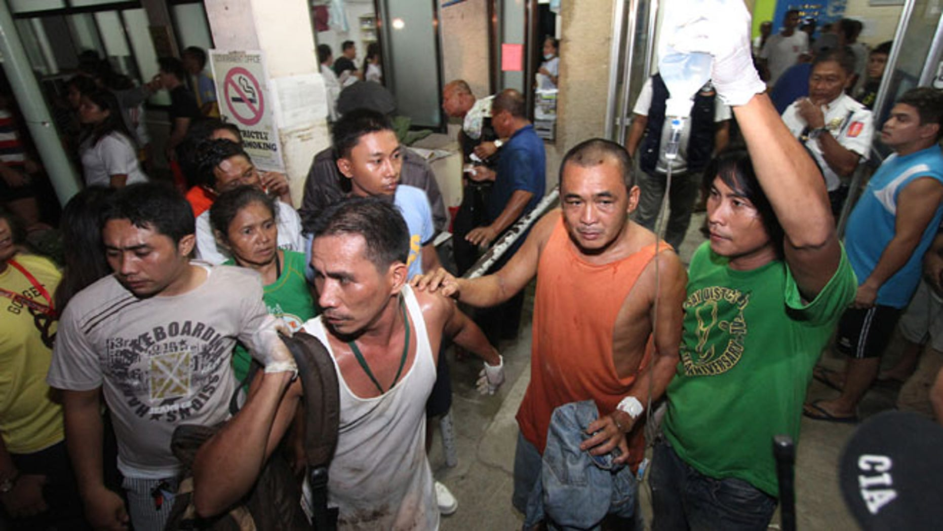 Aug 16, 2013: A survivor goes out of a hospital in Cebu, central Philippines. Passenger ferry MV Thomas Aquinas with nearly 700 people aboard sank near the central Philippine port of Cebu on Friday night after colliding with a cargo vessel, and a survivor said he saw bodies in the sea.