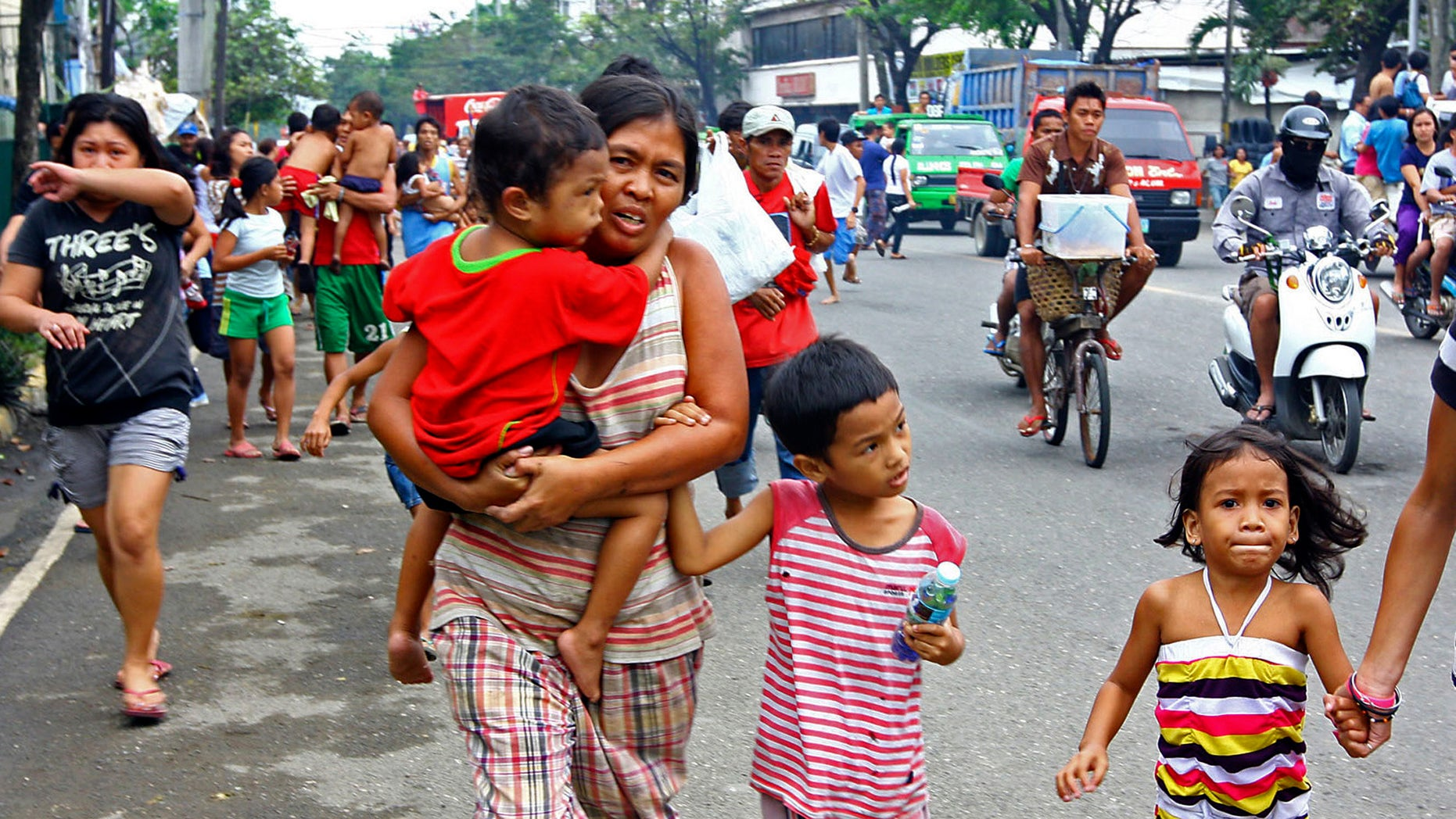 Feb. 6, 2012: Residents rush to higher grounds following tsunami rumors due to a magnitude 6.9 earthquake which hit the island province of Cebu and other central Philippine provinces.