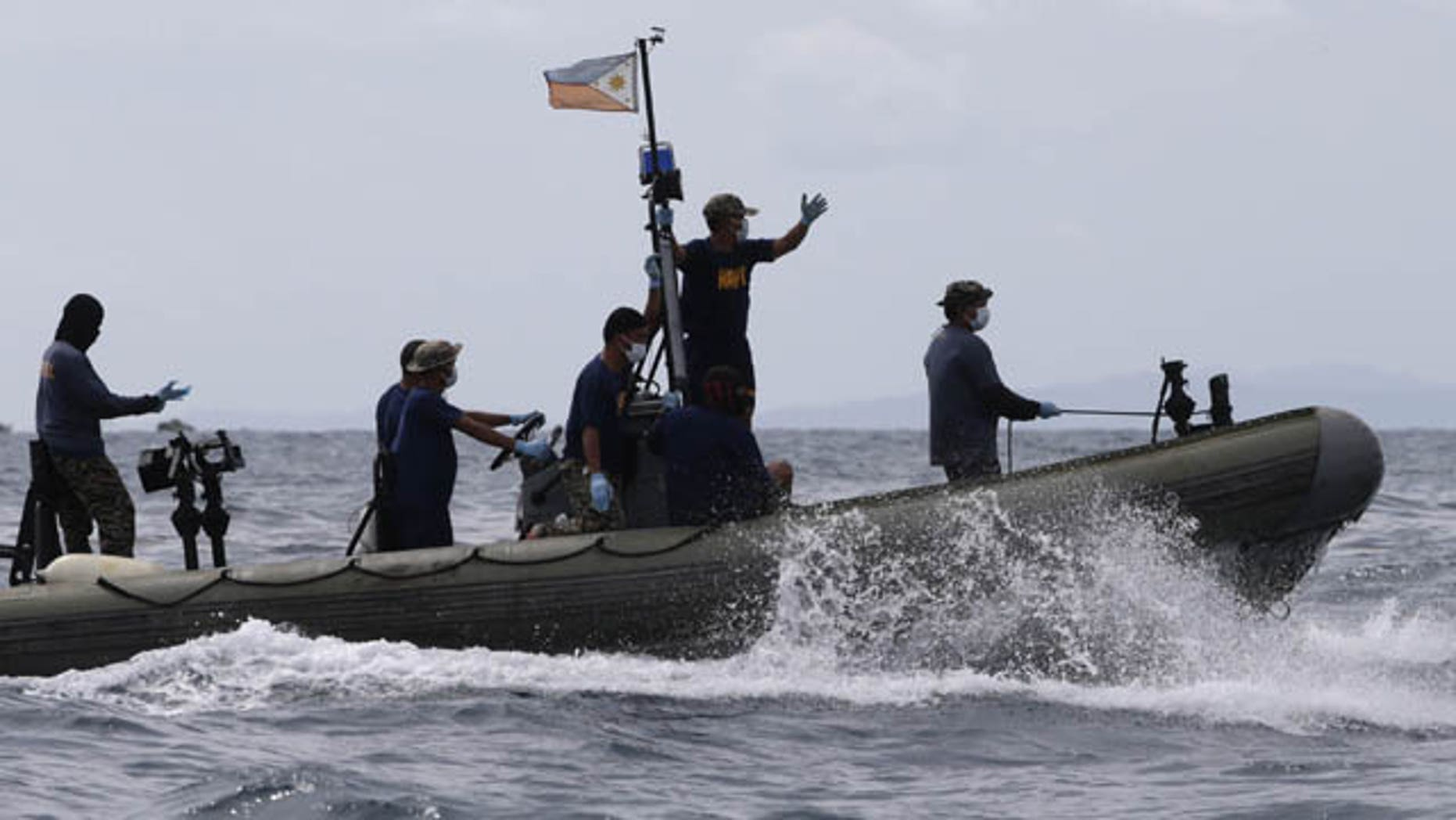 August 18, 2013: Philippine Navy and Coast Guard divers continue their search and rescue operation off Talisay coast, Cebu province following Friday night's collision of the passenger ferry MV Thomas Aquinas and the cargo ship MV Sulpicio Express Siete in central Philippines.