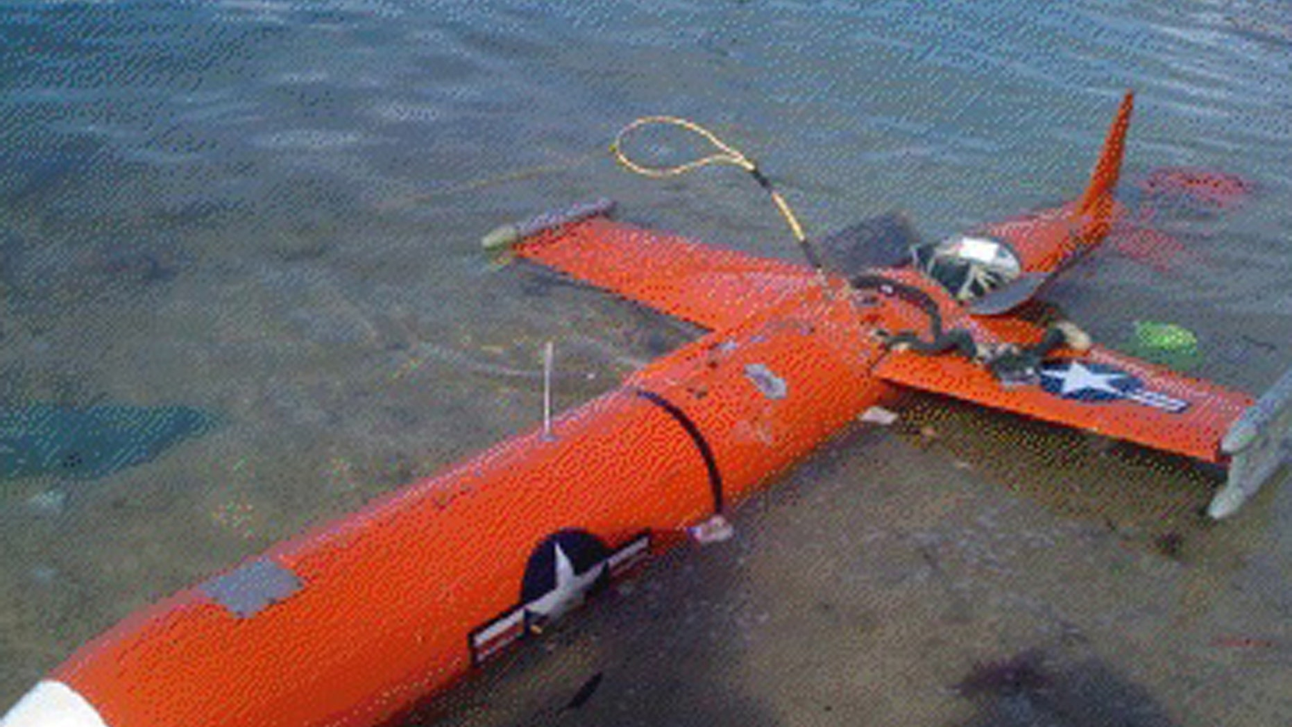 Jan. 6, 2013 - A suspected American drone is brought ashore off Masbate Island in Central Philippines. Photo released by Office of the Deputy Commander Naval Forces, Southern Luzon.