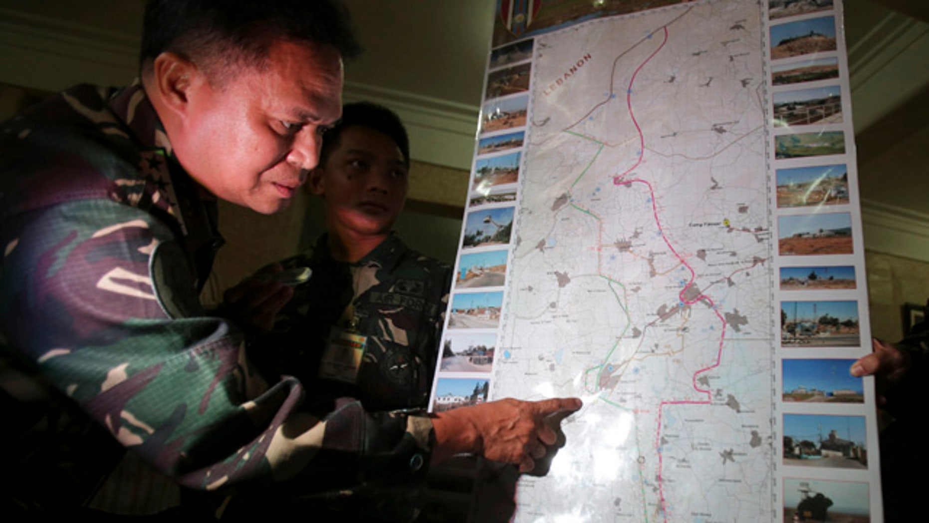 August 31, 2014: Philippine military chief Gen. Gregorio Pio Catapang shows reporters where Filipino peacekeepers in Golan Heights have been repositioned during a press conference at Camp Aguinaldo military headquarters in suburban Quezon city, Philippines. Catapang said more than 70 Filipino peacekeepers have escaped from two areas in the Golan Heights that came under attack by Syrian rebels. (AP Photo/Aaron Favila)