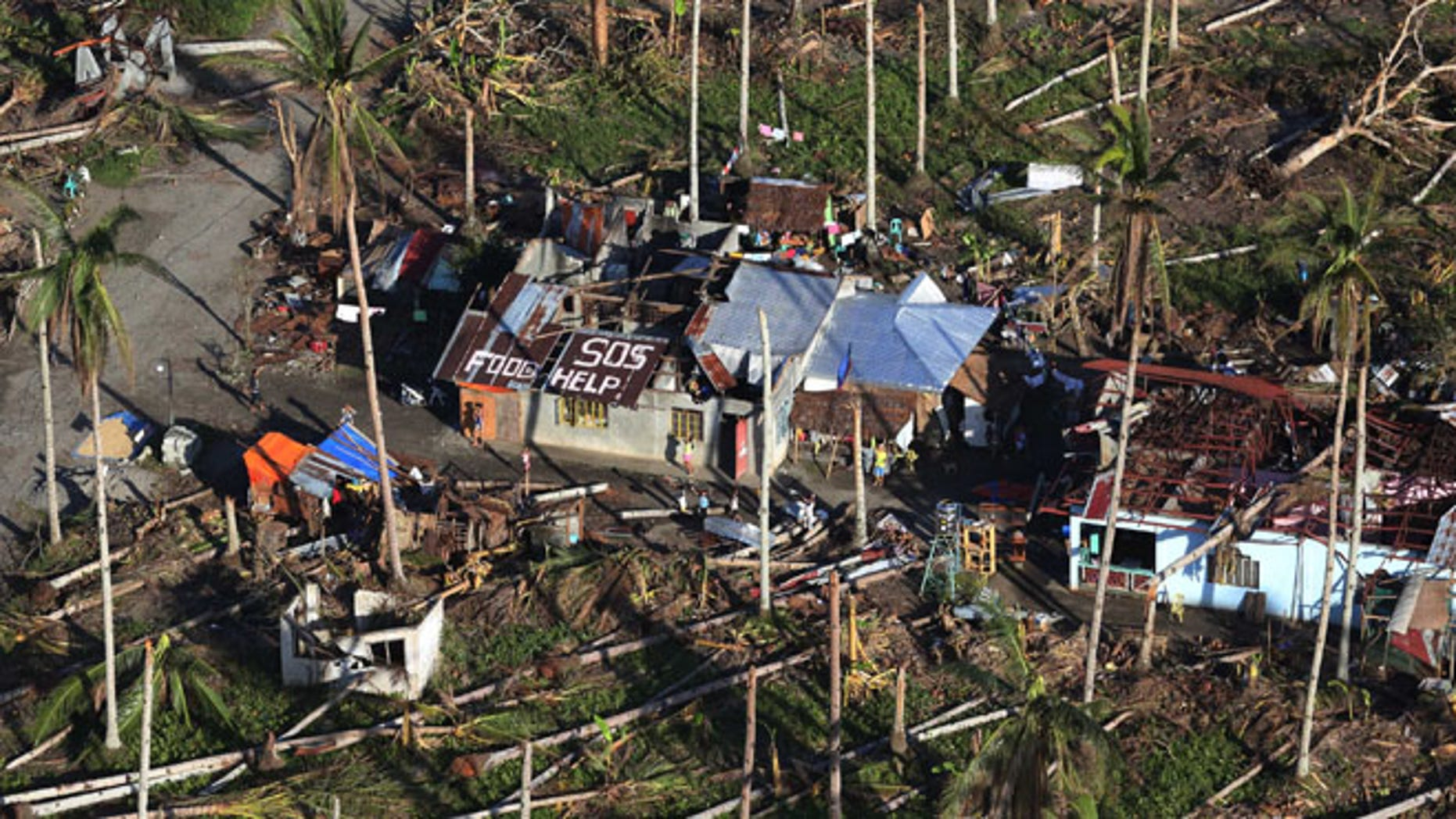 Aerial shot from a Philippine Air Force helicopter at typhoon-ravaged Leyte province, central Philippines, Monday, Nov. 18, 2013.