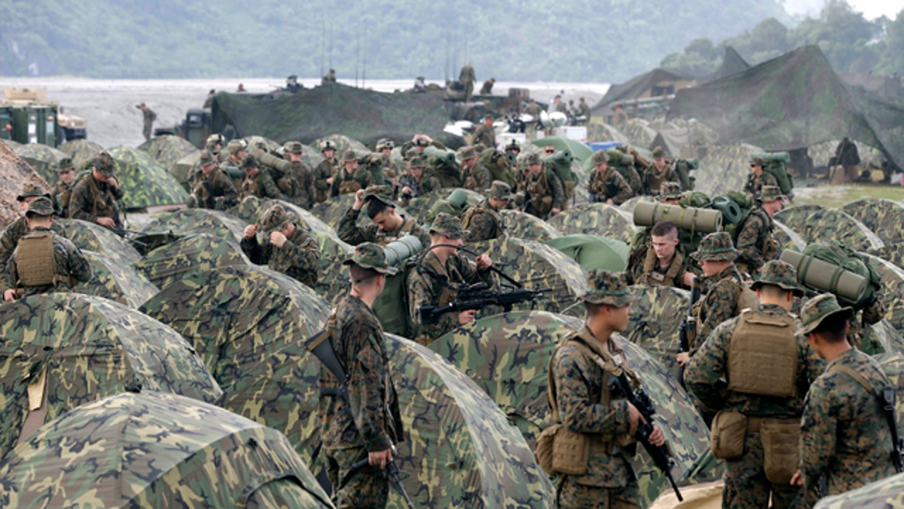 Oct. 9, 2012: In this file photo, U.S. Marines fix their tents as they arrive at Crow Valley, Tarlac province in northern Philippines, to take part in the joint U.S.-Philippines amphibious landing exercise, dubbed PHIBLEX 2013.