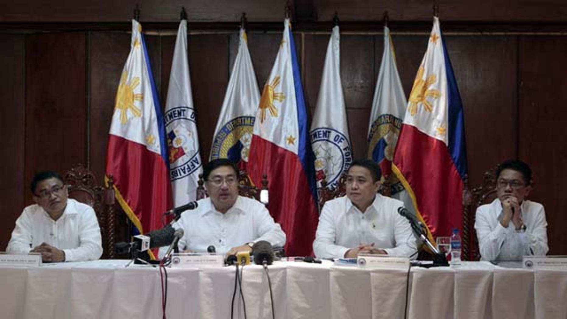 August 12, 2013: Philippine chief government negotiator Carlos Sorreta, second from left, answers questions from reporters beside fellow negotiators, at Camp Aguinaldo military headquarters in suburban Quezon City, north of Manila.