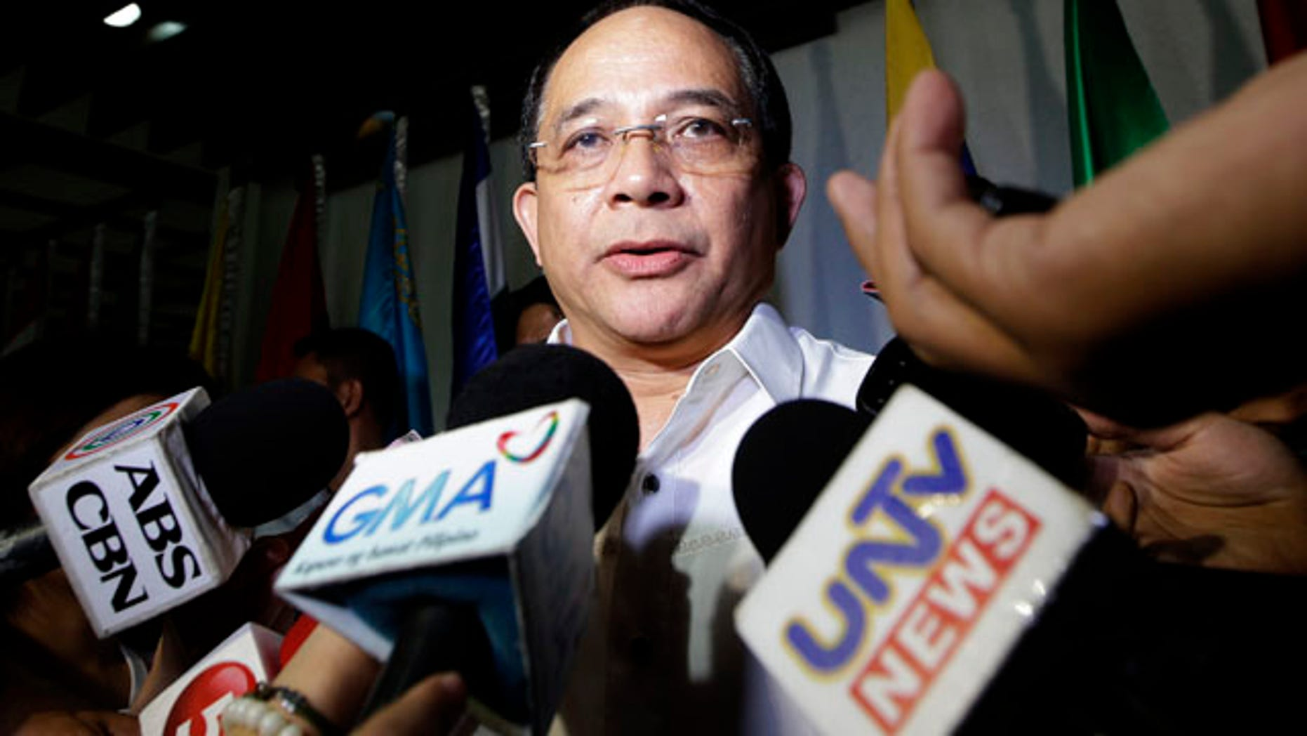 October 13, 2014: Eduardo Oban Jr., head of the Visiting Forces Agreement Commission which is tasked to paving the way for hundreds of U.S. forces to hold combat exercises with Filipino troops in the south, talks to the media on the possible involvement of a 'foreigner' in the killing of a transgender at Olongapo city, in northwestern Philippines, which houses a former U.S. naval base off Subic Bay. (AP Photo/Bullit Marquez)