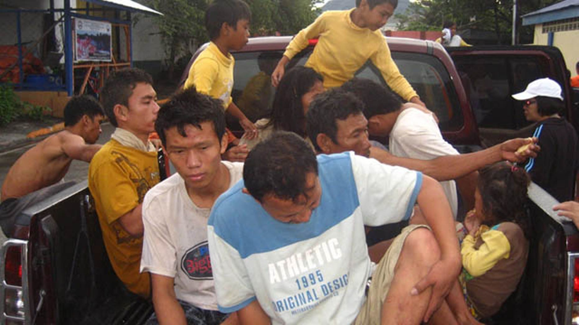 December 18, 2011: Rescued residents board a vehicle at  Iligan city, southern Philippines.