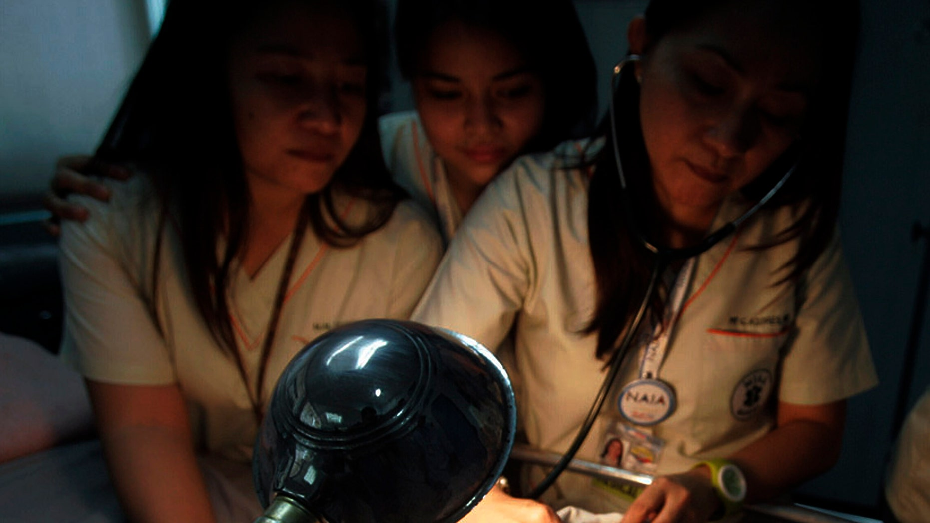 Nurses attend to a newborn baby found inside the lavatory of an airplane Sunday, Sept. 12, 2010, at Manila's international airport, Philippines.