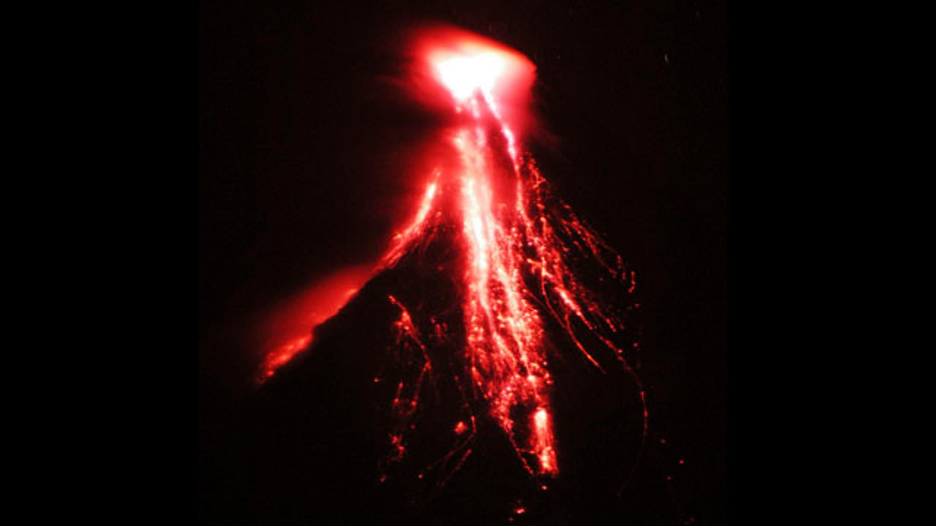 Lava cascades down the slopes of Mayon volcano in Legazpi city, Albay province, Monday Dec. 14, 2009, about 310 miles south of Manila. The Philippine Institute of Volcanology and Seismology, PHIVOLCS, has raised the five-alert level to three following increased activity of the country's most active volcano and residents are prohibited from venturing into the 4-mile permanent danger zone.