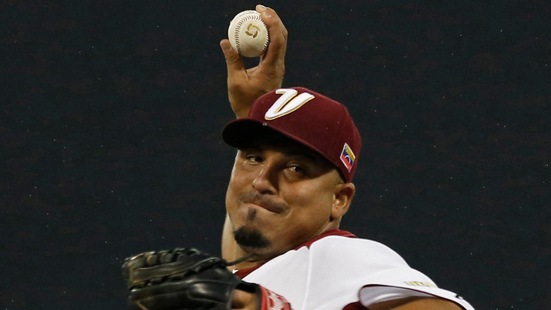 In this March 9, 2013 photo, Venezuela starting pitcher Carlos Zambrano throws in the first inning of a World Baseball Classic first round game against Puerto Rico in San Juan, Puerto Rico.