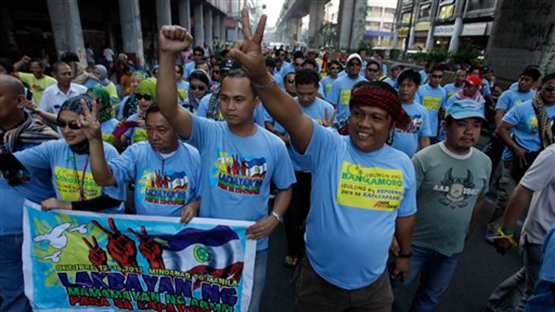 Oct. 14, 2012: Filipino Muslim men and supporters march as they join a rally in support of a preliminary peace agreement between the government and the nation's largest Muslim rebel group outside the Malacanang presidential palace in Manila, Philippines.