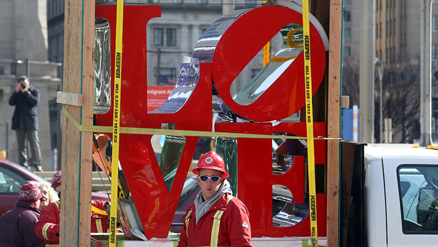 """""""LOVE"""", the famous 1976 Robert Indiana sculpture, is parked in front of John F. Kennedy Plaza before reinstallation, Tuesday Feb. 13, 2018 in Philadelphia. The sculpture was removed for repairs a year ago while its home, the downtown park, was going through a renovation. (AP Photo/Jacqueline Larma)"""