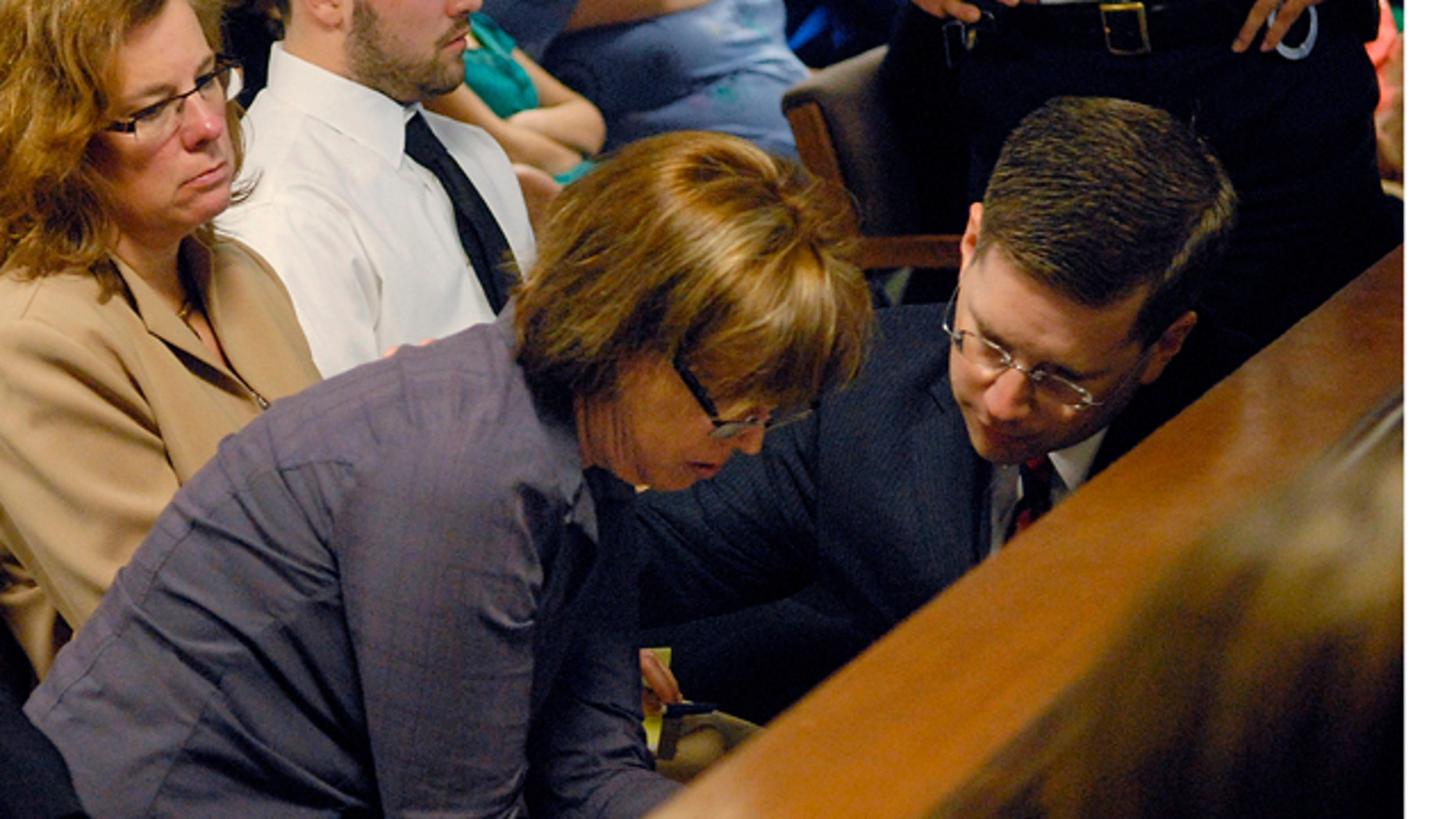May 4: Anne O'Brien, mother of Phoebe Prince, talks with First Assistant District Attorney Steven Gagne during Kayla Narey's hearing where she admitted to sufficient facts of criminal harassment in Franklin - Hampshire Juvenile Court in Northampton, Mass.