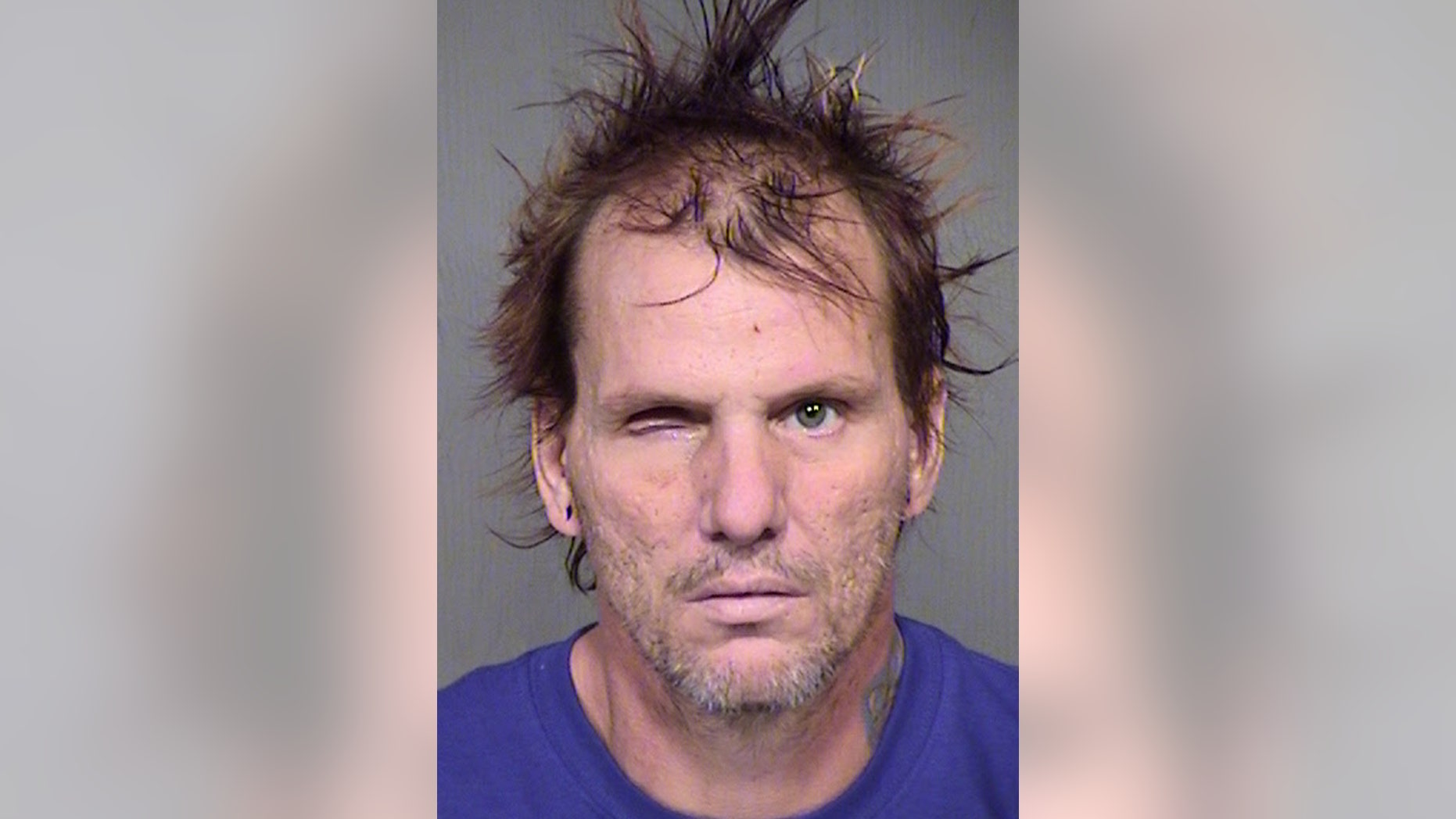 This booking photo provided by the Maricopa County Sheriff's Office shows 43-year-old Kenneth Dale Wakefield. Investigators say Wakefield killed and decapitated his 49-year-old wife, Trina Heisch, and their two dogs and then inflicted injuries on himself, including a severed left forearm and a missing eye. He was booked into Maricopa County jail Saturday afternoon, Aug. 1, 2015, on one count of first-degree murder and two counts of animal cruelty. (Maricopa County Sheriff's Office via AP)
