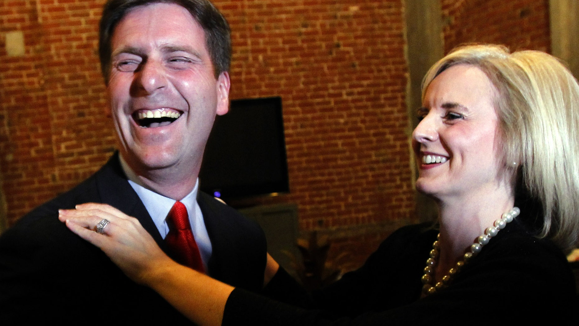 Democratic candidate for Phoenix mayor Greg Stanton, left, celebrates with his wife Nicole France Stanton after learning about positive early election results, Tuesday, Nov. 8, 2011, in Phoenix. Stanton defeated Republican Wes Gullett to become the new mayor of Phoenix. (AP Photo/Ross D. Franklin)