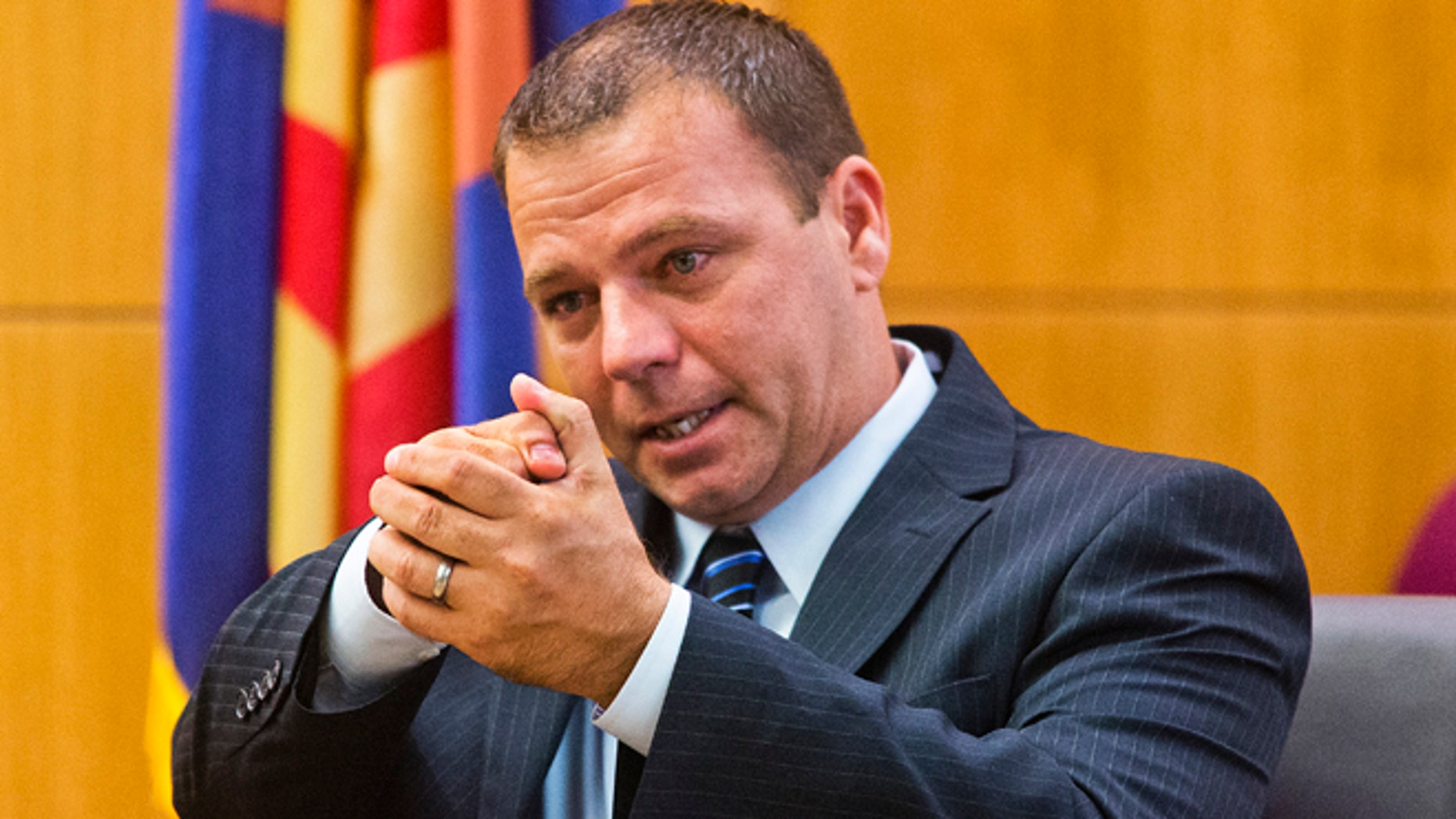 Sept. 3, 2013: Phoenix Police Officer Richard Chrisman testifies about firing his weapon at Danny Frank Rodriguez in Oct. 2010  in the living room of a South Phoenix trailer in Maricopa County Superior Court in Phoenix.