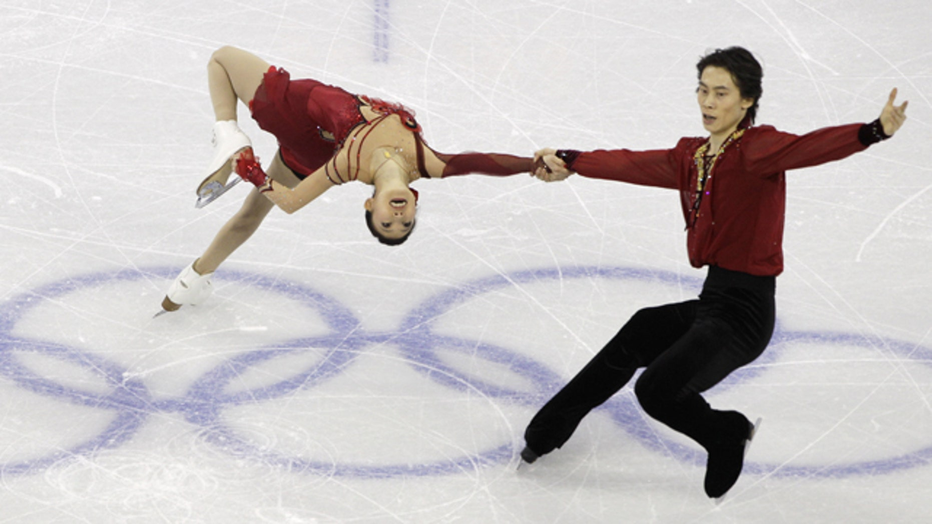 China's Pang Qing and Tong Jian perform their pairs free program during the figure skating competition at the Vancouver 2010 Olympics in Vancouver, British Columbia, Monday, Feb. 15, 2010.