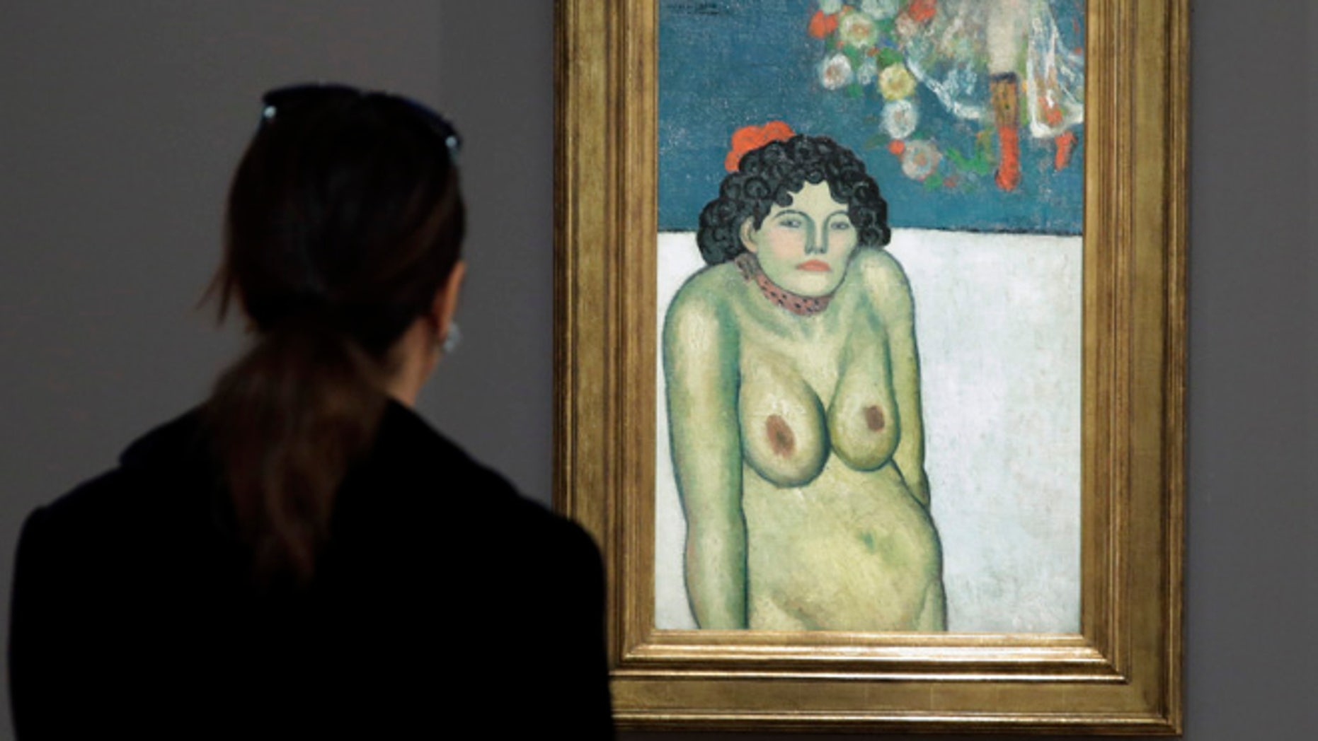 "FILE - This Oct. 30, 2015 file photo shows ""The Nightclub Singer,â a 1901 painting by Picasso from his Blue Period, at Sotheby's in New York. The work features a second picture on the reverse side depicting Picassoâs art dealer, Pere Manach. The piece is estimated to fetch $60 million on Thursday night, Nov. 5, 2015 at Sothebyâs fall art auction. (AP Photo/Richard Drew, File)"