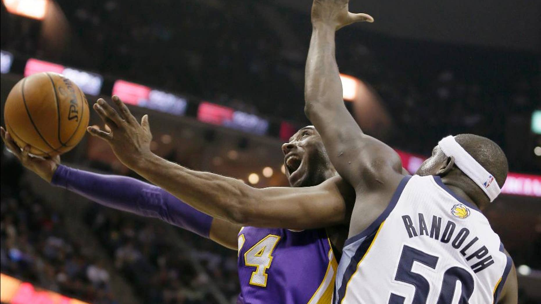 FILE - In this Dec. 17, 2013, file photo, Los Angeles Lakers' Kobe Bryant goes to the basket in front of Memphis Grizzlies' Zach Randolph (50) during the first half of an NBA basketball game in Memphis, Tenn. Bryant's 19th season gets started Tuesday, Oct. 28, 2014, when the Lakers open at home against the Houston Rockets. What he has left in the tank after two injury-filled years might be one of the biggest questions heading into the season, with the Lakers already being widely written off in the loaded Western Conference and Bryant hardly expected to regain the elite form that he displayed for so long. (AP Photo/Danny Johnston, File)