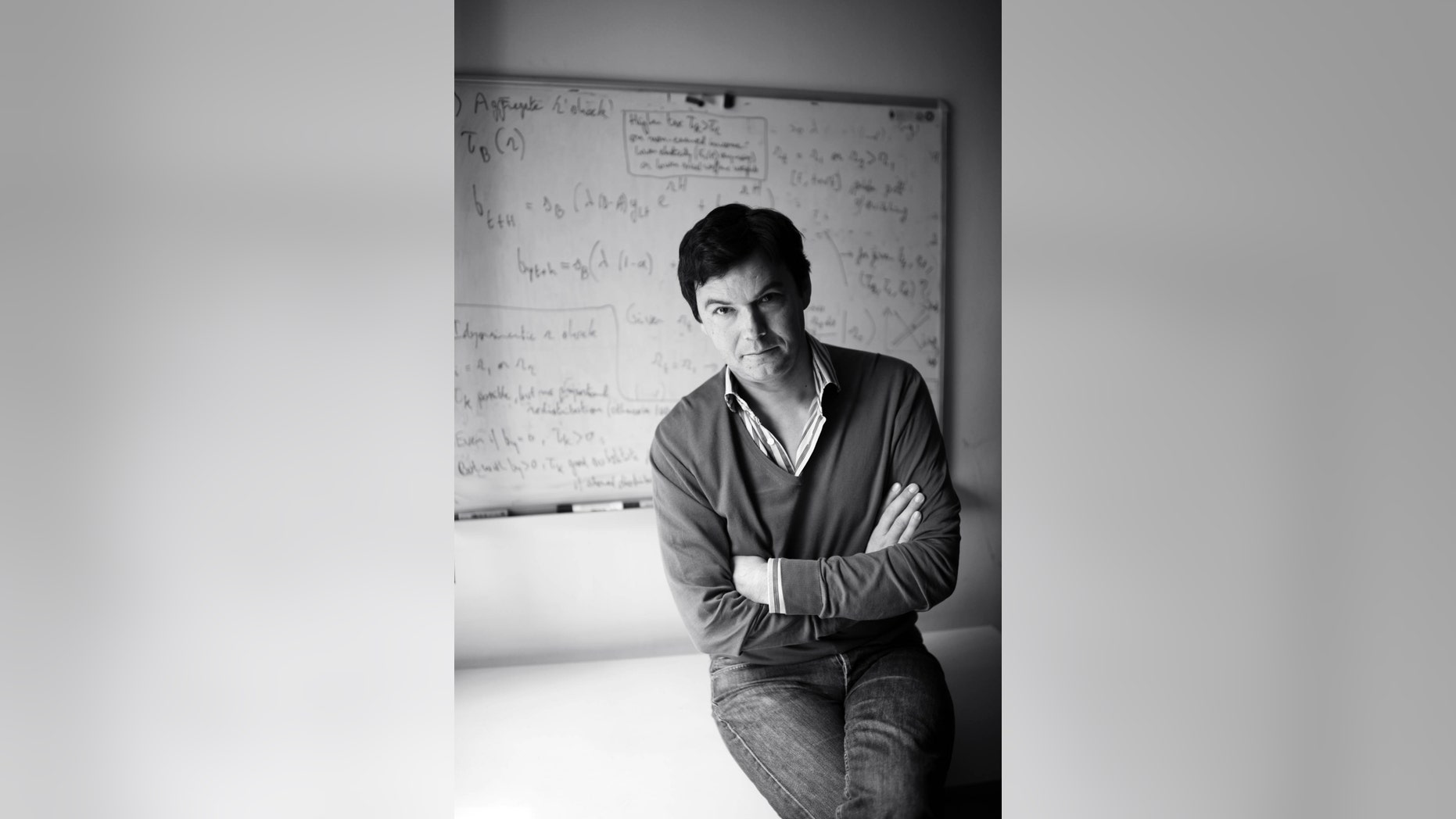 FILE -- This undated photo provided by Harvard Press shows French economist Thomas Piketty. In his new book, Piketty, who helped popularize the notion of a privileged 1 percent, sounds a grim warning: The U.S. economy is beginning to decay into the aristocratic Europe of the 19th century.