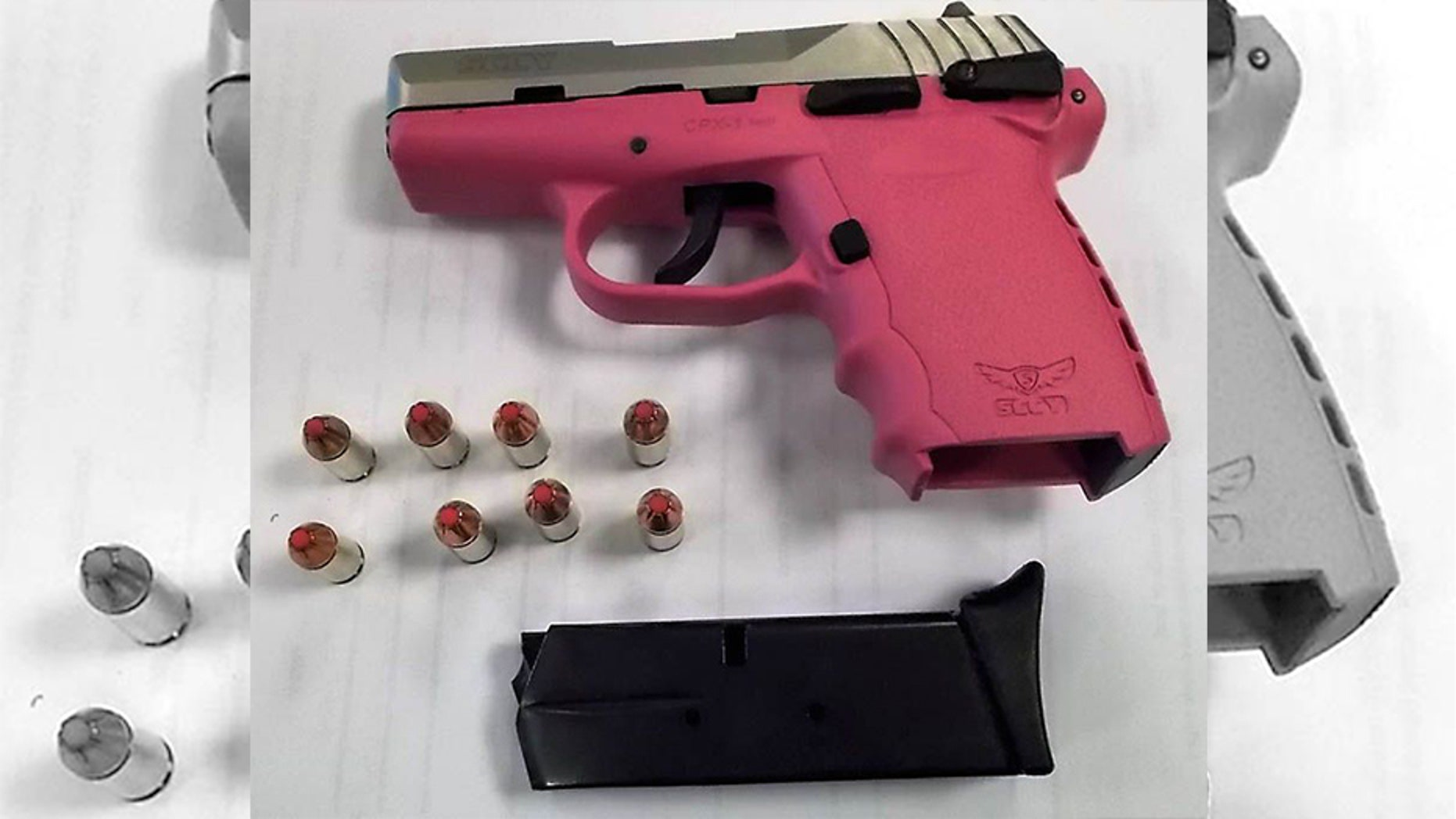 A woman was arrested after her hot pink gun was found at an airport security checkpoint, loaded with 8 pink-tipped bullets.