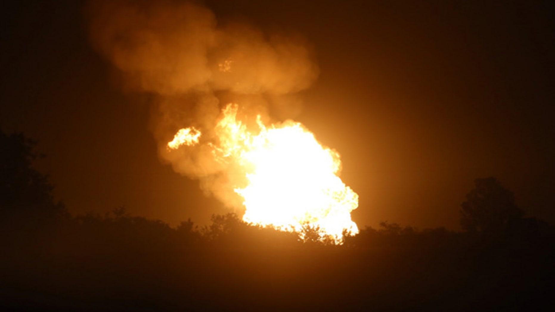 June 14, 2015: Fire after a pipeline explosion in rural DeWitt County, Texas, illuminates the horizon. Authorities said no one was injured after a natural gas pipeline rupture sparked a massive fire that prompted home evacuations in South Texas. (Richard Hoang/The Victoria Advocate via AP)