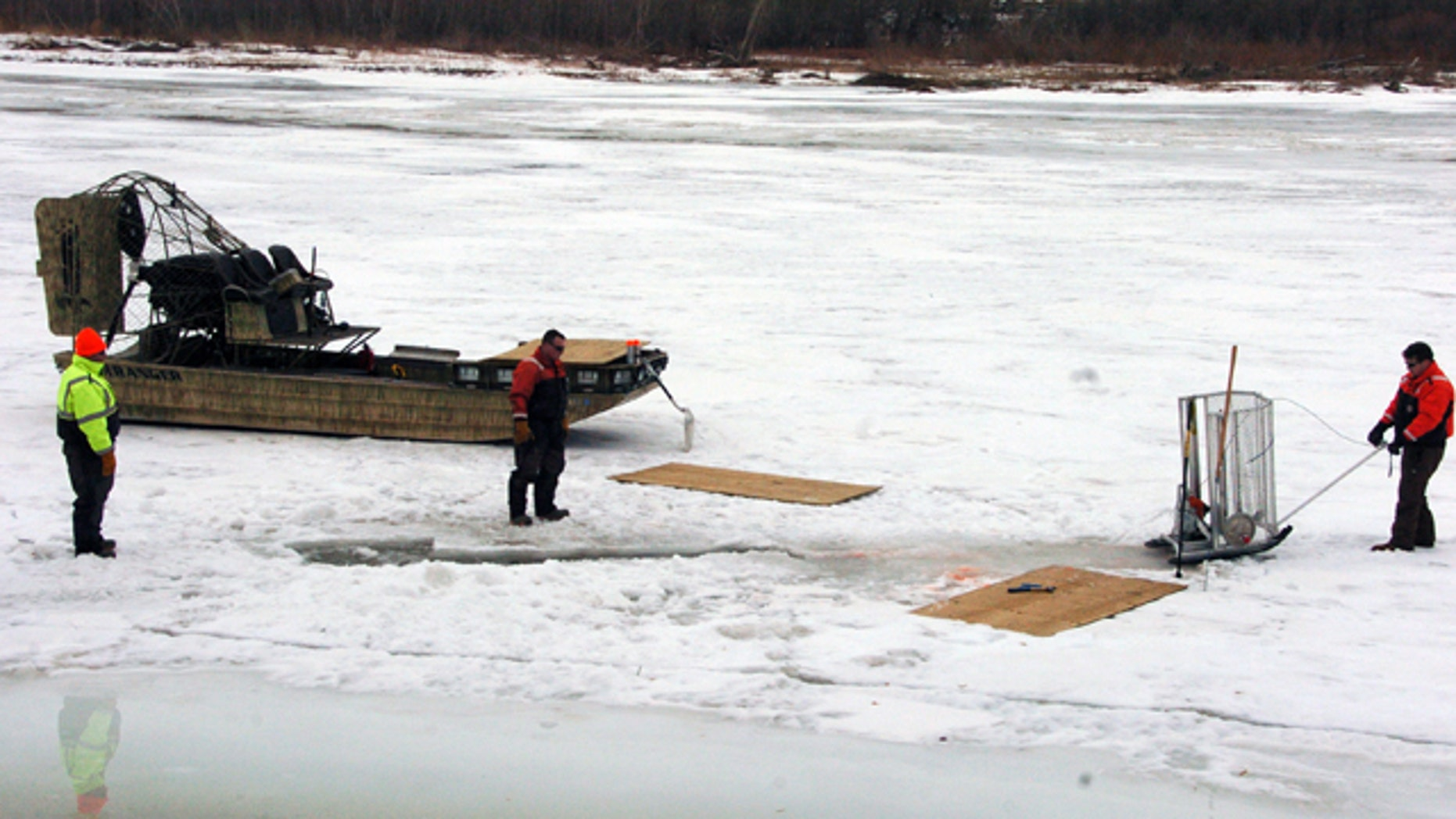 Jan. 19, 2015: Cleanup workers cut holes into the ice on the Yellowstone River near Crane, Mont, as part of efforts to recover oil from an upstream pipeline spill that released up to 50,000 gallons of crude. (AP Photo/Matthew Brown)