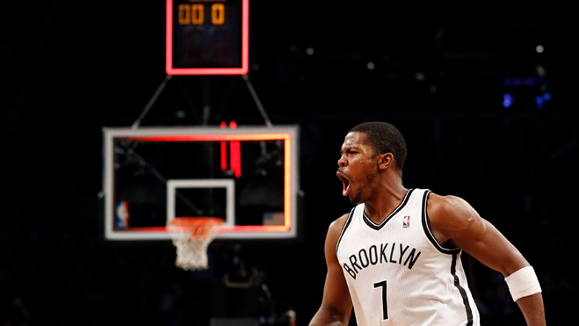 Brooklyn Nets guard Joe Johnson (7) celebrates after hitting the game winning shot for a 107-105 victory in double overtime against the Detroit Pistons after their NBA basketball game at Barclays Center, Friday, Dec. 14, 2012, in New York. (AP Photo/John Minchillo)