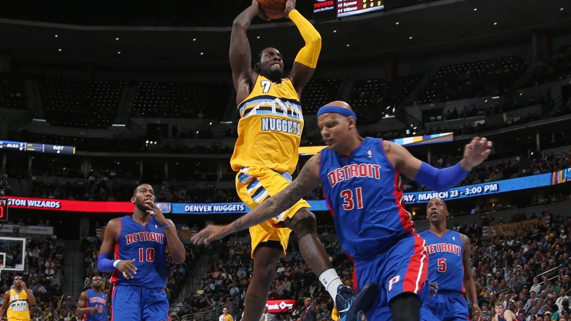 Denver Nuggets forward J.J. Hickson, center, drives for basket as Detroit Pistons forward Charlie Villanueva, right, and center Greg Monroe cover in the fourth quarter of the Nuggets' 118-109 victory in an NBA basketball game in Denver on Wednesday, March 19, 2014. (AP Photo/David Zalubowski)