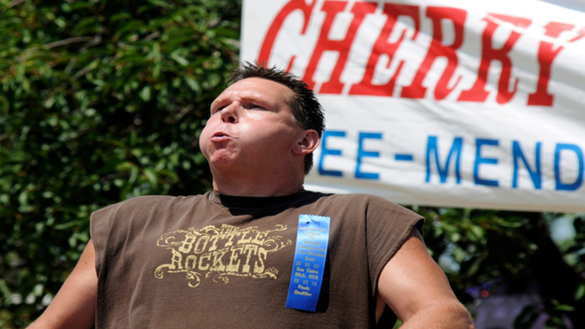 July 7, 2012: Ronn Matt places first in the championship division of the 39th annual International Cherry Pit Spitting Championship at Tree-Mendus Fruit Farm in Eau Claire, Mich.