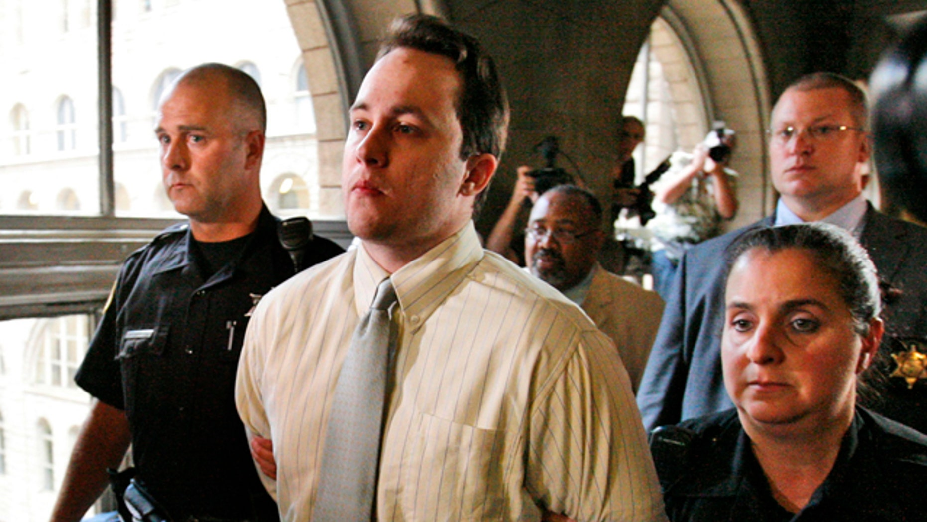 June 28: Richard Poplawski, center, is escorted by Allegheny County Sherriffs after being sentenced to death by lethal injection for the killing of three Pittsburgh Police officers.