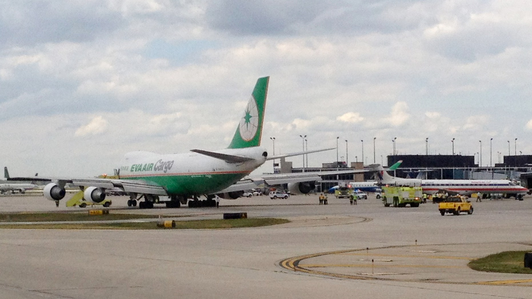 May 30, 2012: Emergency crews surround an An Eva Air Cargo plane, left, after it clipped the rudder of an American Eagle plane, right, at Chicago O'Hare International Airport in Chicago.