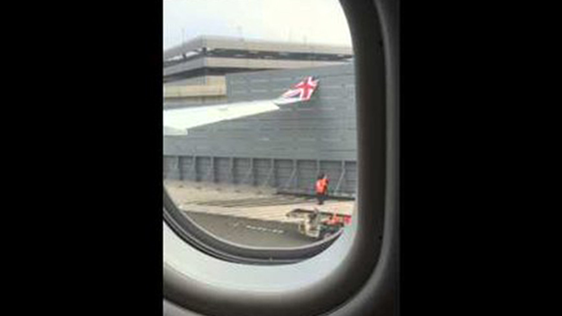 The wing of a London-bound flight made contact with a gate at New York's John F. Kennedy International Airport in this photo.