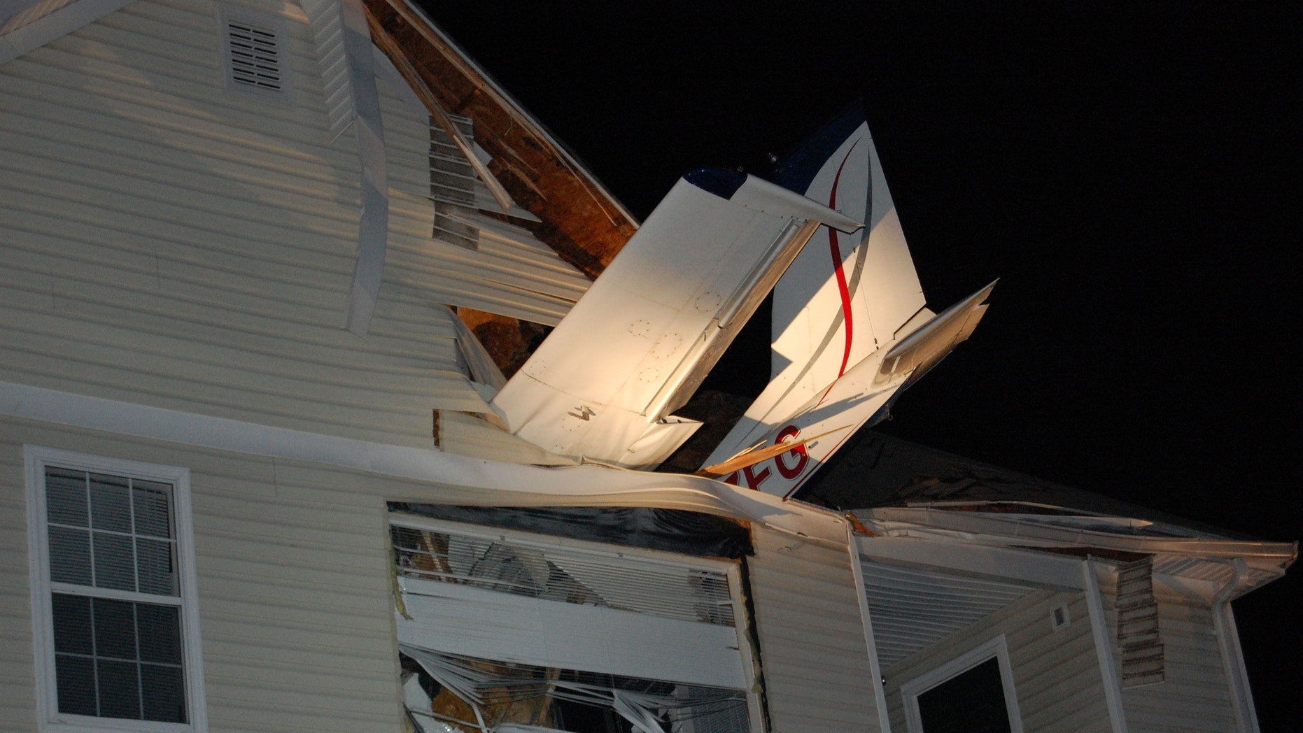 May 31, 2013: This handout photo provided by the Virginia State Police shows a small plane crashed into the living room of an apartment in Herndon, Va. Capt. Willie Bailey with Fairfax County Fire and Rescue in Virginia says the plane ran out of fuel early Friday and crashed, injuring two people  one in the apartment and one in the Cessna 177B.