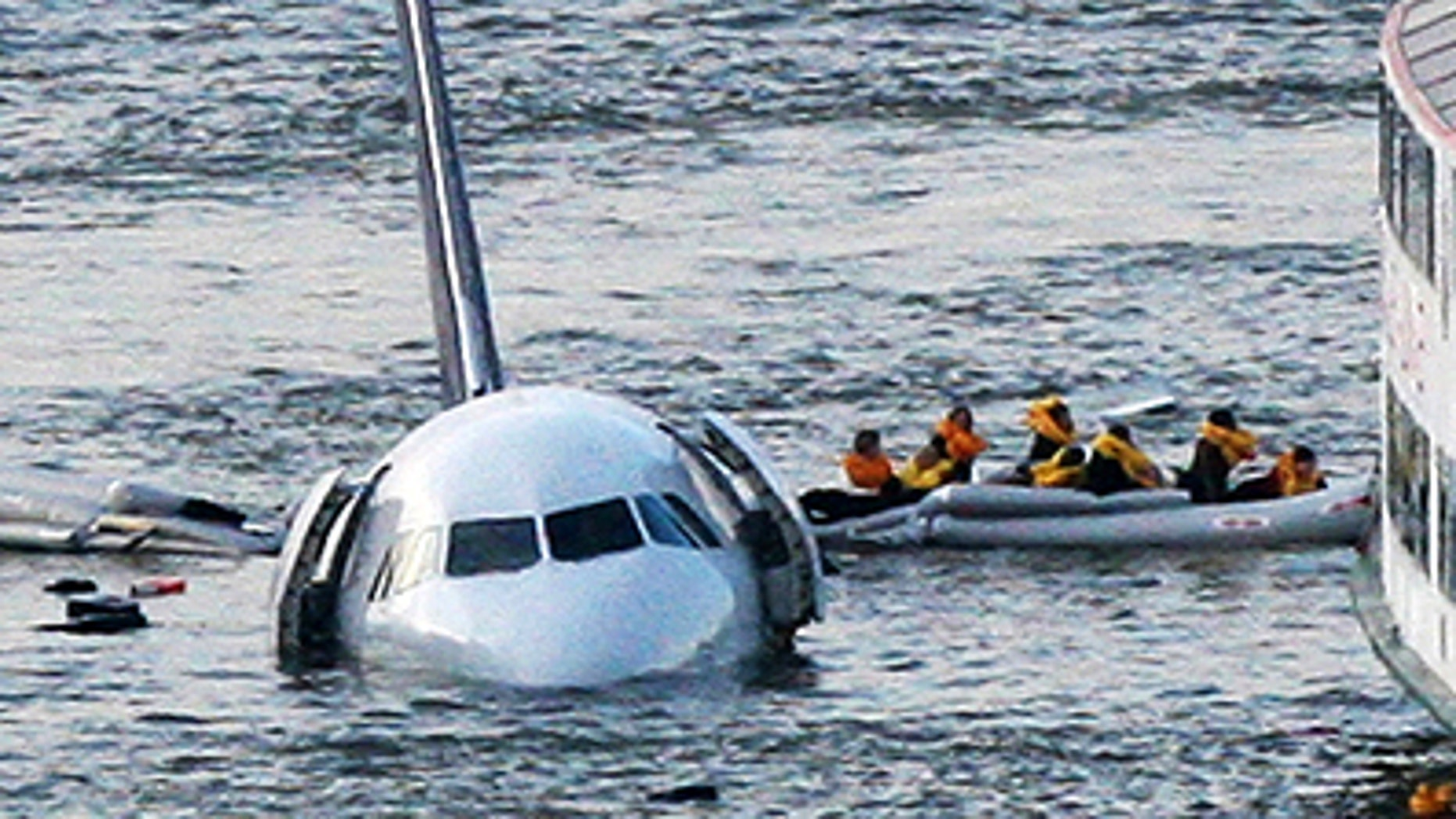 In this Jan. 15, 2009 file photo, passengers in an inflatable raft move away from an Airbus 320 US Airways aircraft that has gone down in the Hudson River in New York. The Charlotte Observer reported Wednesday, Jan. 5, 2011 that the Carolinas Aviation Museum in Charlotte, N.C. has almost completed an agreement to buy the US Airways jet that made a near-miraculous landing on the Hudson River in 2009 from the insurance company that owns it.   (AP Photo/Bebeto Matthews, FILE)