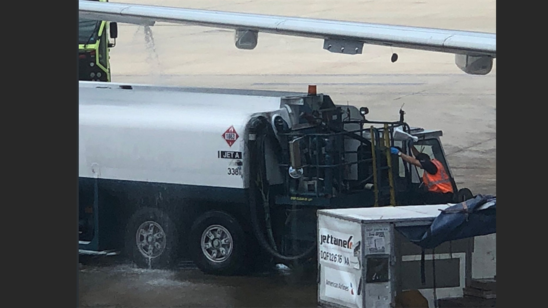 An American Airlines flight was delayed after fuel was seen leaking from the plane wing.