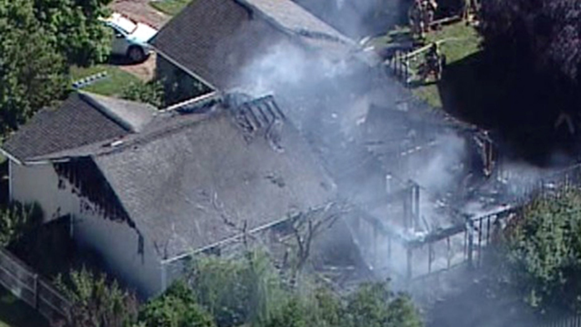 July 25: In this frame grab, smoke rises from a house in Columbus, Ind., after a small plane crashed into the home injuring two people who were on the plane.