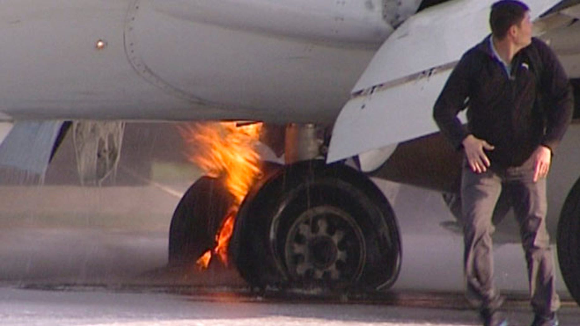May 18, 2013:  Passengers leave a Boeing 737 belonging to Russian carrier UTair in Vnukovo airport, Russia. Emergency officials said the landing gear of a plane carrying more then 130 people caught on fire as it was landing. All passengers and crew members were safely evacuated.